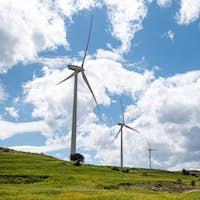 Windmills power generators on a turbine farm generating electricity from wind. Alternative renewable