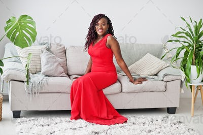 Magnificent young african woman in luxurious red dress