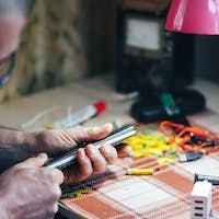 man hands repair make broken tv remote