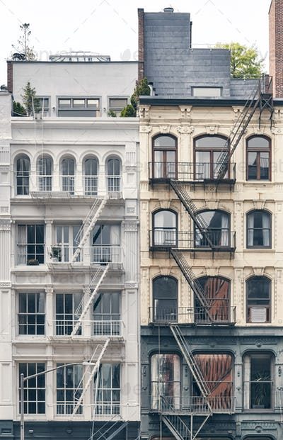 Old residential buildings with iron fire escapes, New York City, USA.
