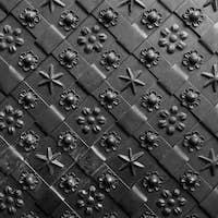 Black forged door, rhombus symmetrical texture. Grunge black background