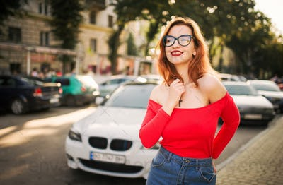 Attractive redhaired woman in eyeglasses