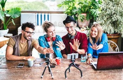 Young friends startupper group having fun on streaming platform with webcam