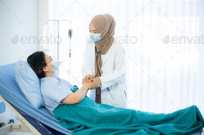 Muslim doctors explain the health examination results to patient that receives annual health checks