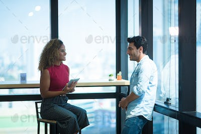 A couple of two business part talking and consulting at the co-working space