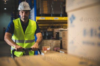 Male warehouse worker portrait in warehouse storage