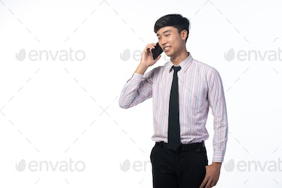 A portait of business man taking a mobile phone call for meeting conference with customer