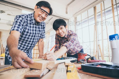 Carpenters team work together creatively, creative carpenter working with wood and tools