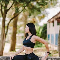 young woman meditation yoga practice morning routine outdoors in park