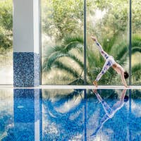 beautiful sporty woman yoga asana practice morning routine