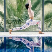 sportive woman yoga practice morning relaxation on vacation resort