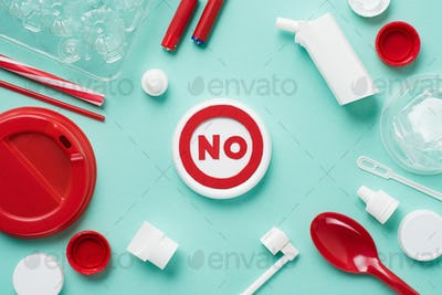 Top view of no sign and disposable plactic wares on blue background