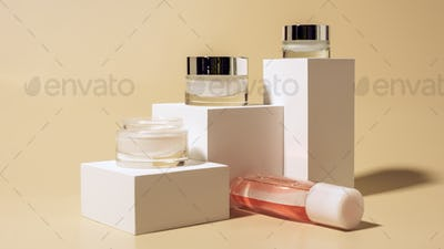 close up view of micellar water and body creams on white cubes on beige background