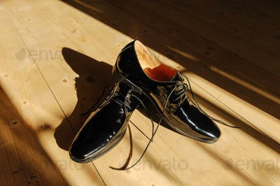 Black men's shoes in bright sunshine