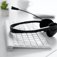Headset and keyboard on the desk in the office