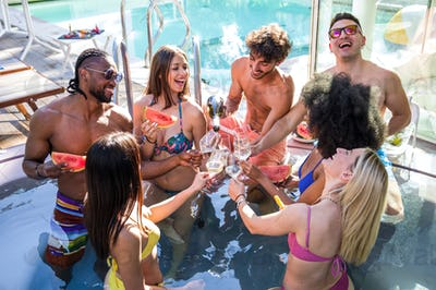 Group of multiracial happy friends making a pool party