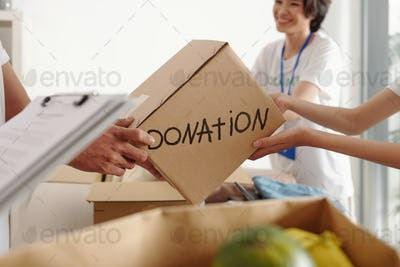Man donating box of groceries