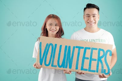Smiling young volunteers