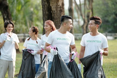 People cleaning city park