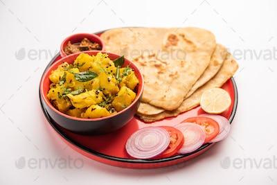 Potato or Aloo Sabji with Triangle Paratha. Indian food
