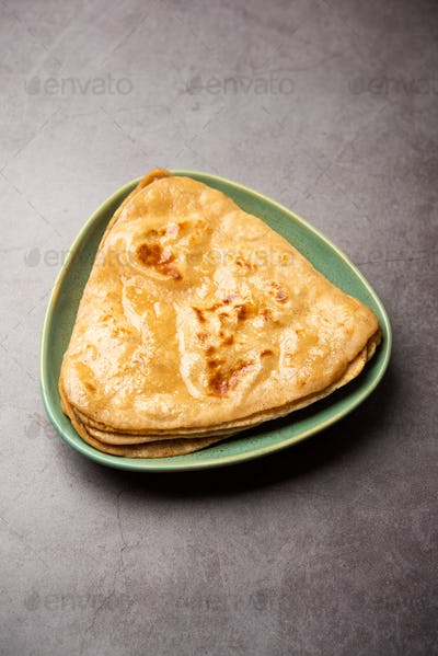 Triangle shape parantha or paratha is an Indian flat bread made with wheat flour and ghee or oil