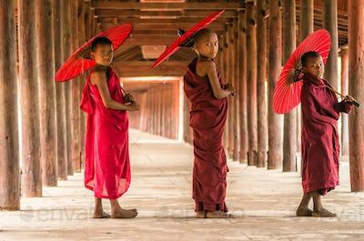 Three Buddhist novice are walking in pagoda,myanmar