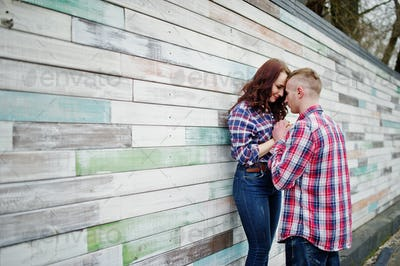 Stylish couple wear on checkered shirt in love together.