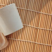 Fork and cup on the bamboo mat