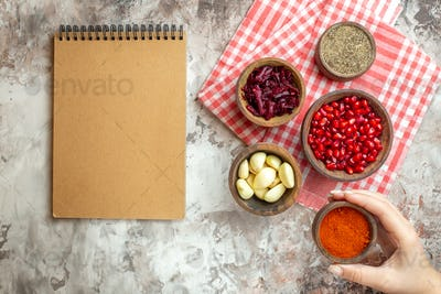 top view different seasonings garlics pomegranates and beet on the light background ripe color