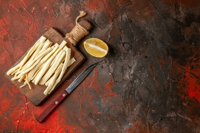 top view fresh cheese sliced on wooden desk on dark background darkness meal snack photo color cips