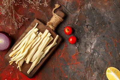 top view fresh cheese sliced on wooden desk on dark background darkness snack photo color cips