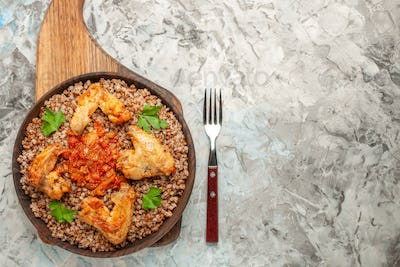 top zoomed view here we see black wheat in the wooden bowl with chicken wings tomato souce on the