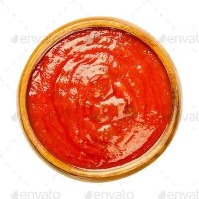 Tomato sauce with herbs, Neapolitan sauce, salsa roja, in wooden bowl