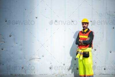 Portrait of a foreman or engineer working in an international shipping area