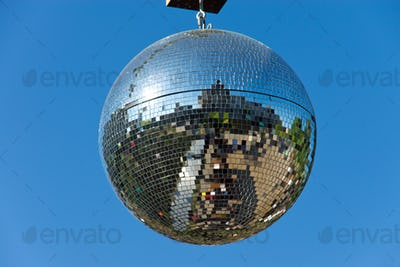 Disco ball with blue sky