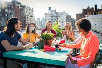 Group of friends having party on a rooftop