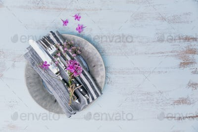 Rustic Table Setting with Pink Flowers on Light Wooden Table