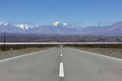 Straight road and Aconcagua mountains, North of Argentina
