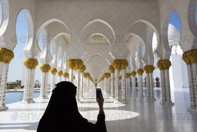 Woman and selfie at Sheikh Zayed Mosque in Abu Dhabi