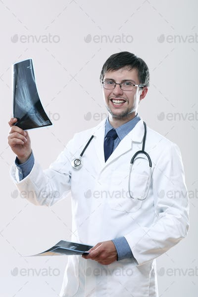 Young doctor looking at x-ray image