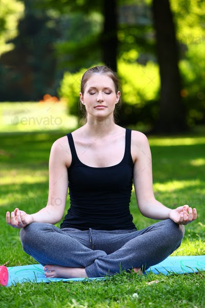 Beautiful woman relaxing in yoga pose