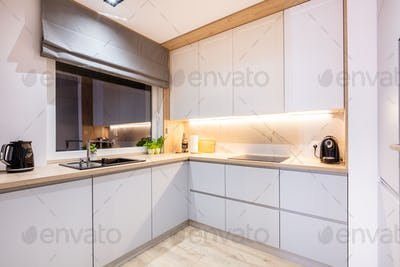 Kitchen furniture in a modern small apartment for rent.
