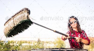 Woman at carwash station - Inside view