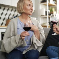Two generation women drinking wine at home