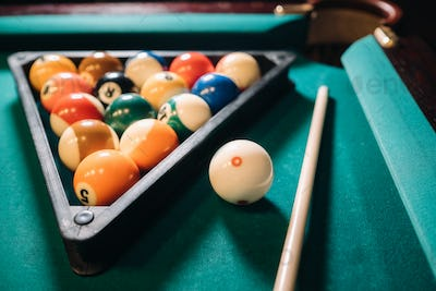 Billiard table with green surface and balls in the billiard club.Pool Game