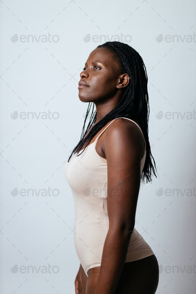 """Beautiful girl posing in studio for a """"body positivity"""" photo session"""