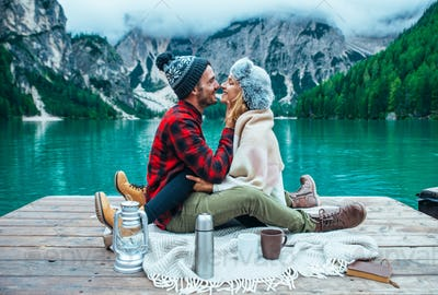 Mountain stories. Happy couple on a wanderlust vacation.