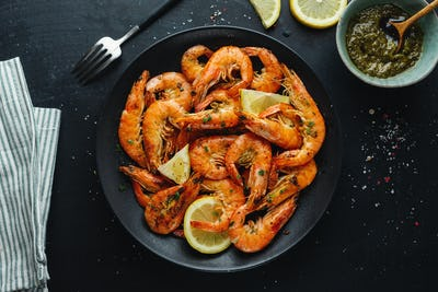 Shrimps with spices on plate