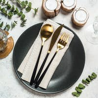 Table setting with white plate, cutlery and eucalyptus
