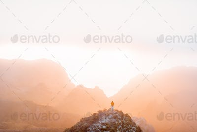Mountain range under the clouds on a sunset